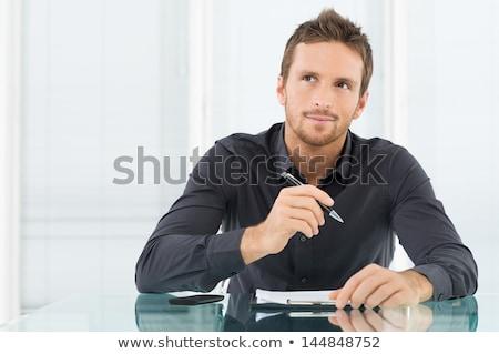 笑みを浮かべて · 若い男 · 帳 · ペン · 白 · 紙 - ストックフォト © stockyimages