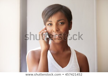 Brunette listening attentively to phone call Stock photo © photography33