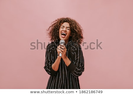 Stock photo: Brunette holding microphone