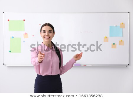 Teacher pointing stock photo © ajfilgud