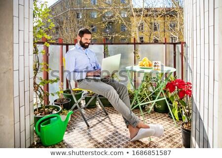 бизнесмен используя ноутбук балкона компьютер работу ноутбук Сток-фото © photography33