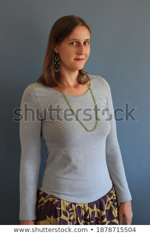 pretty smiling blonde in a gray skirt stock photo © acidgrey