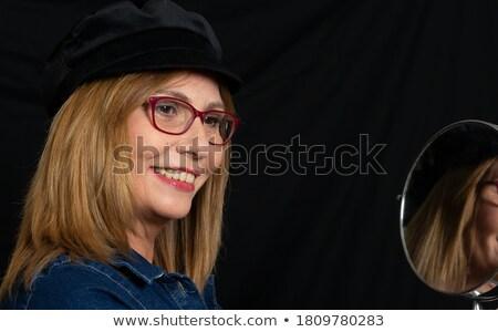 Glimlachend jonge blond zwarte minirok geïsoleerd Stockfoto © acidgrey