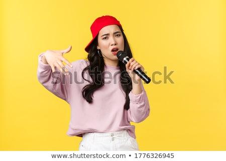 jonge · rapper · meisje · breed · jeans · geïsoleerd - stockfoto © acidgrey