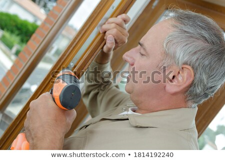 grey haired handyman with cordless drill stock photo © photography33