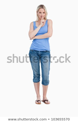 Blonde woman telling to be quiet while crossing arms against a white background Stock photo © wavebreak_media