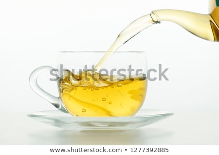 Yeşil çay fincanı yalıtılmış beyaz çay kahvaltı Stok fotoğraf © Grazvydas