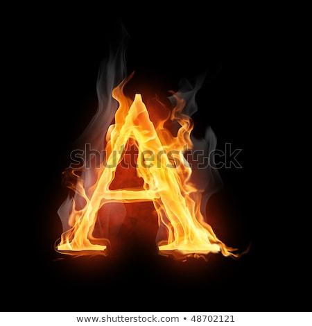 Foto stock: Símbolo · brillante · negro · fuego · resumen · película
