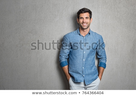 Successful Handsome Stylish Young Man in Blue Shirt standing Stock photo © gromovataya