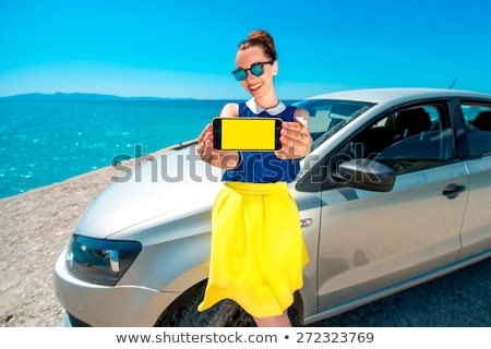 woman standing near car, wide angle Stock photo © chesterf