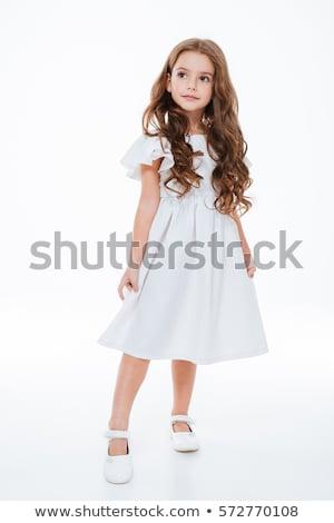 kislány · eső · gyermek · pöttyös · esernyő · visel - stock fotó © taden