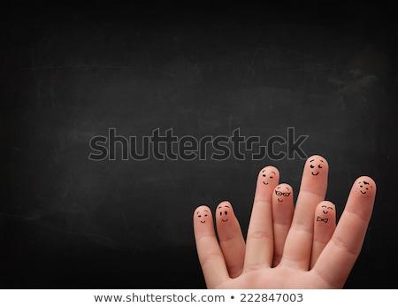 Felice dita guardando vuota nero Foto d'archivio © ra2studio