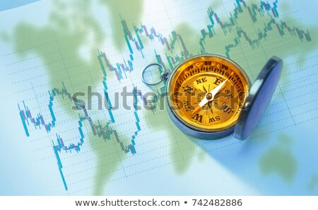 golden growth chart icon on black compass stock photo © tashatuvango