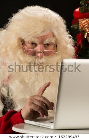 papá · noel · de · trabajo · ordenador · abierto · portátil · blanco - foto stock © hasloo