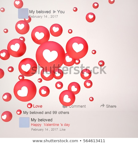 icon of heart in the hand on red keyboard button stock photo © tashatuvango
