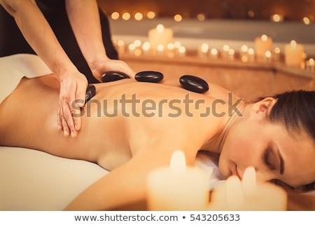 Hot stone massage woman enjoy spa treatment Stock photo © CandyboxPhoto