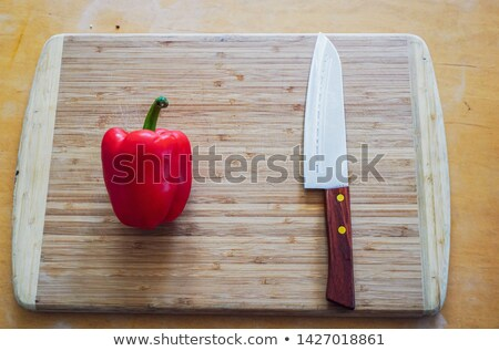 Red papper knife isolated on white background. Stock photo © luckyraccoon