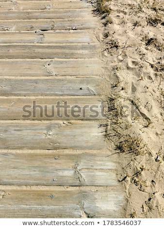 Vintage houten hek zandstrand wolken water Stockfoto © stevanovicigor