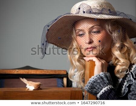 Beautiful retro stylized photo of a pretty woman that looks like Stock photo © Nejron