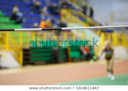 sportswoman jumps in height Stock photo © OleksandrO