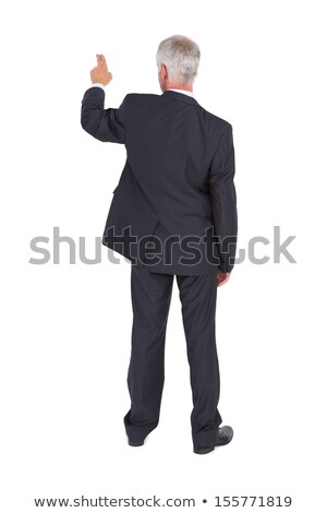 smart businessman pointing away stock photo © stockyimages