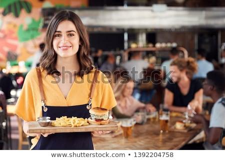 portrait of waitress serving food in restaurant stock photo © highwaystarz