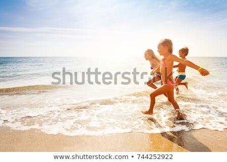 boy at the beach enjoys the sandy beach Stock photo © meinzahn