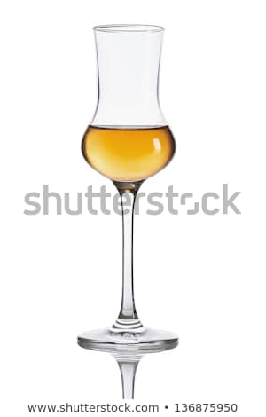 A glass of grappa on a white background Stock photo © Zerbor