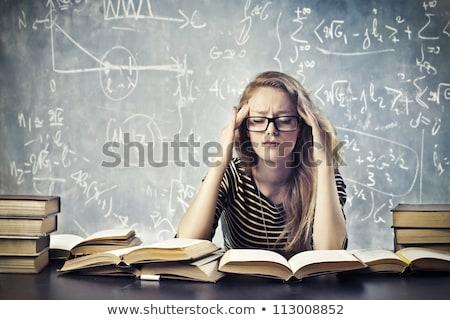 beautiful female student with a headache stock photo © iko