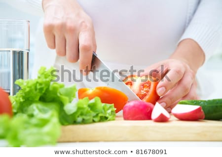 Unrecognizable Woman Cooking at home Stock photo © HASLOO