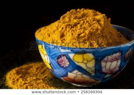 Ground Turmeric in Painted Bone China Bowl Stock photo © Merlot