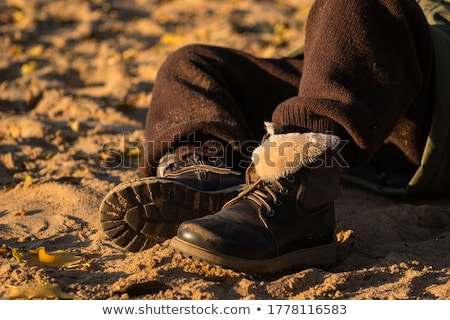 Boys beach hat and shoes on golden sand Stock photo © ozgur