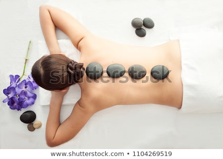 Woman Getting Hot Stones Massage At Spa Stock photo © dash