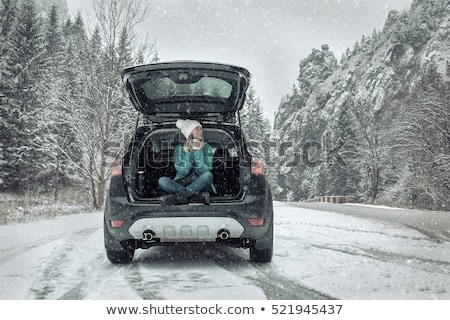 Happy young woman celebrating her winter vacation Stock photo © dash