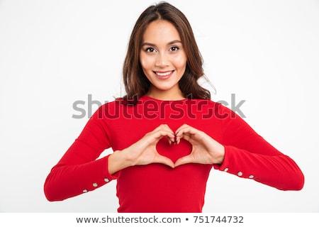 Gülen genç kadın kalp şekli el işareti güzellik Stok fotoğraf © dolgachov