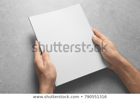 man holding blank brochure as mock up copy space stock photo © stevanovicigor