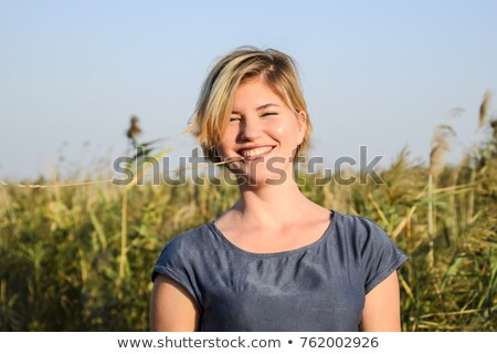 Seductive young woman with a sultry expression Stock photo © dash