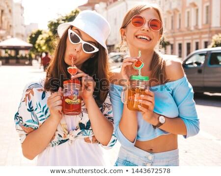 Twee glimlachend jonge sexy meisjes Stockfoto © deandrobot