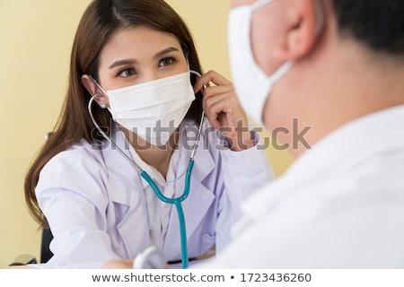 nurse with patient measuring pulse Stock photo © dolgachov
