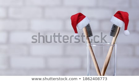 two toothbrushes in a glass  Stock photo © OleksandrO