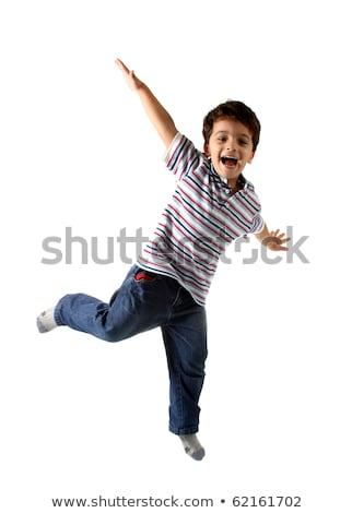 Studio heureux garçon adolescent sautant Photo stock © monkey_business