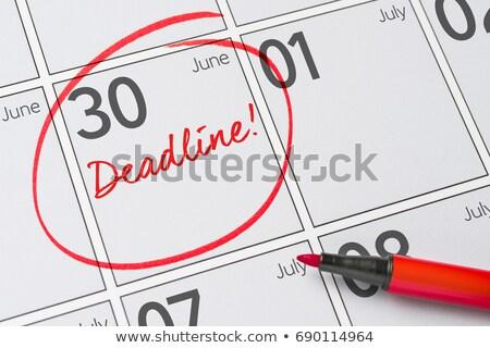 Save the Date written on a calendar - June 30 Stock photo © Zerbor