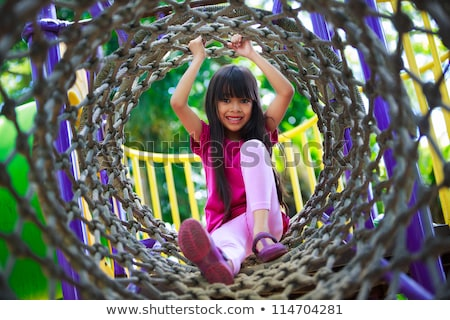Young child plays on swing in the outdoor playground  Stock photo © meinzahn