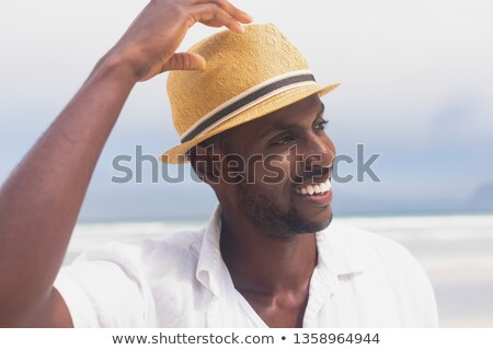 Close up portrait of calm young man looking away Stock photo © deandrobot
