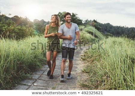 Jóvenes feliz romántica Pareja caminando carretera Foto stock © tekso
