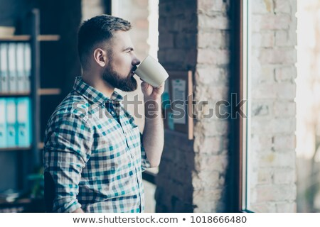 Businessman having coffee break, he is holding a cup  Stock photo © master1305
