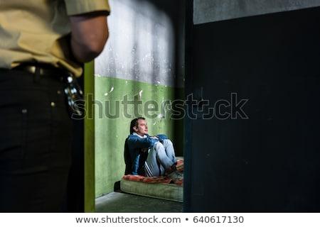 jonge · mannelijke · gevangene · vergadering · alleen · verouderd - stockfoto © kzenon