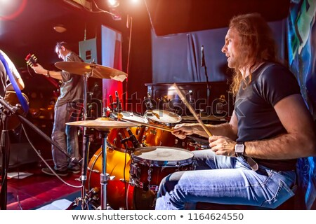 hands of drummer playing drum kit in nightclub stock photo © wavebreak_media