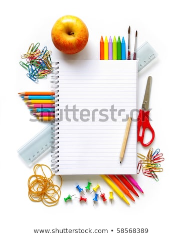 Apple and color pencil on book on white background Stock photo © wavebreak_media
