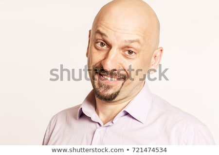 przystojny · łysy · uśmiechnięty · człowiek · portret - zdjęcia stock © filipw
